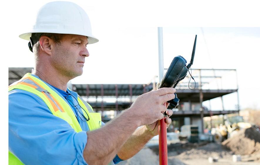 Land Surveyor Overlooking Construction Site