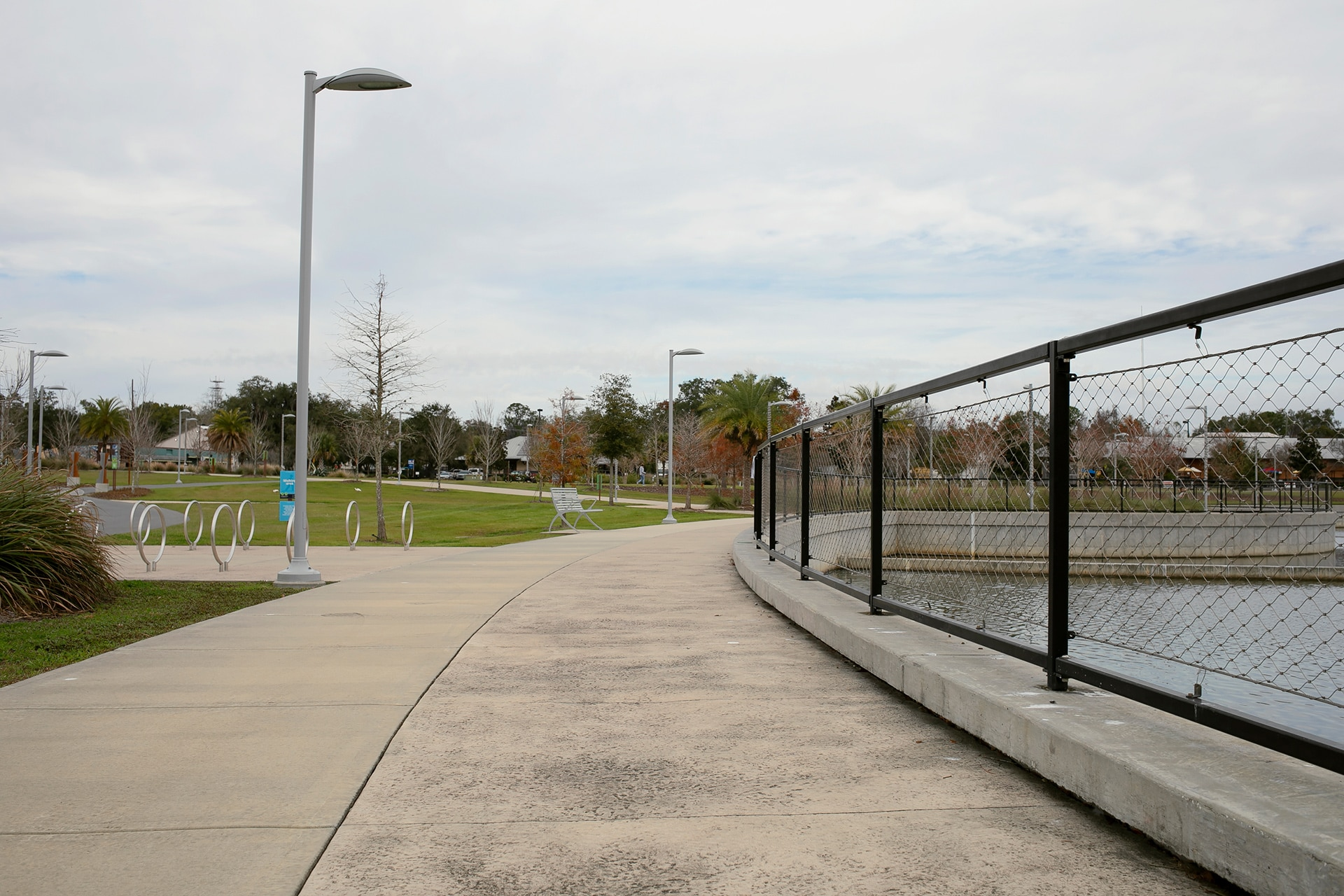 Concrete walkway with water and a protective gate on the side